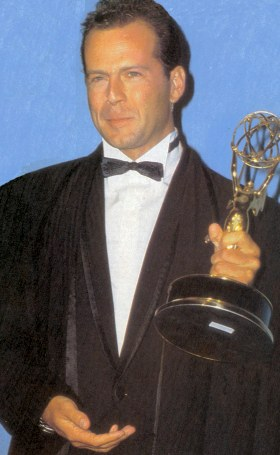 Bruce Willis holding his Emmy for 1987 Best Dramatic Actor in a Leading Role